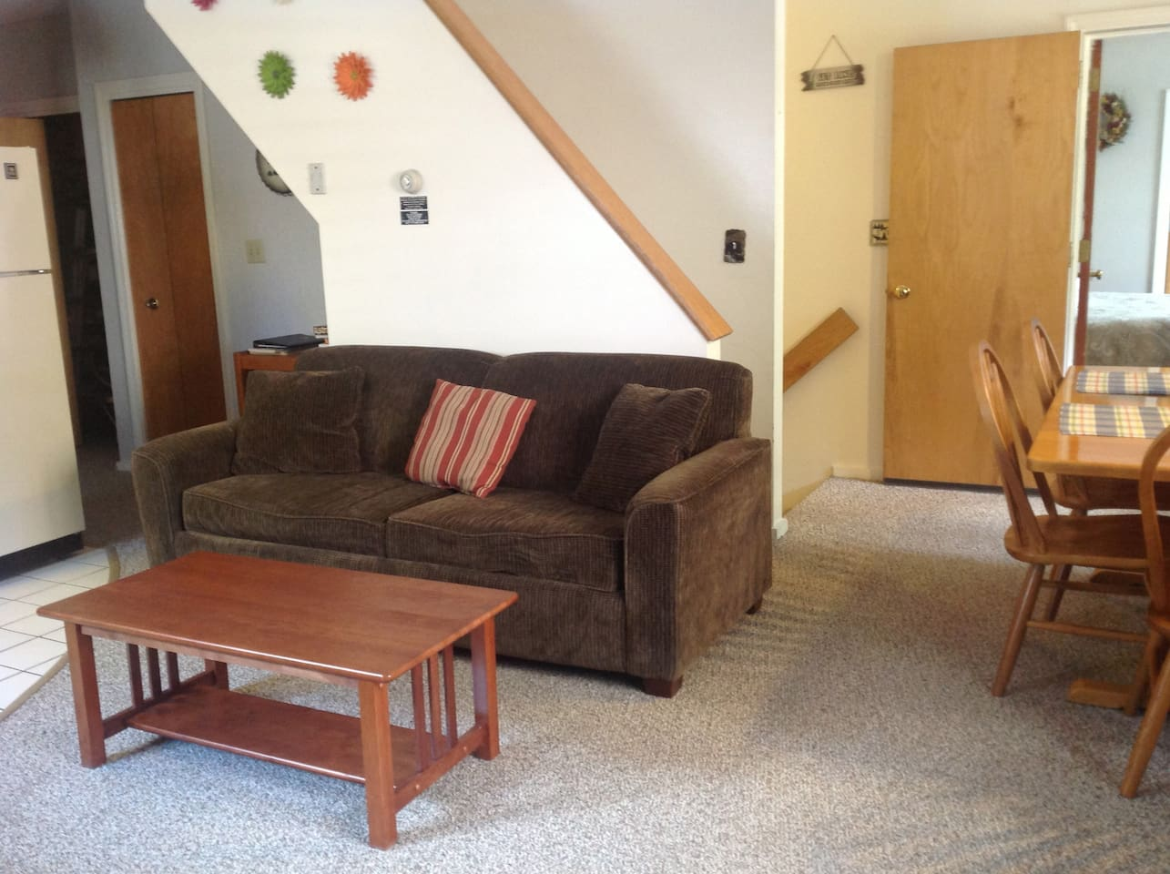 Living room sofa with pull-out Queen bed that is actually comfortable. Stairs to exit and to 2nd bedroom