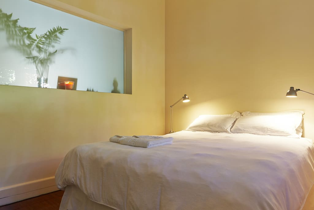 The calm contemporary guest room with comfortable bed, blankets, heater and fan as needed.