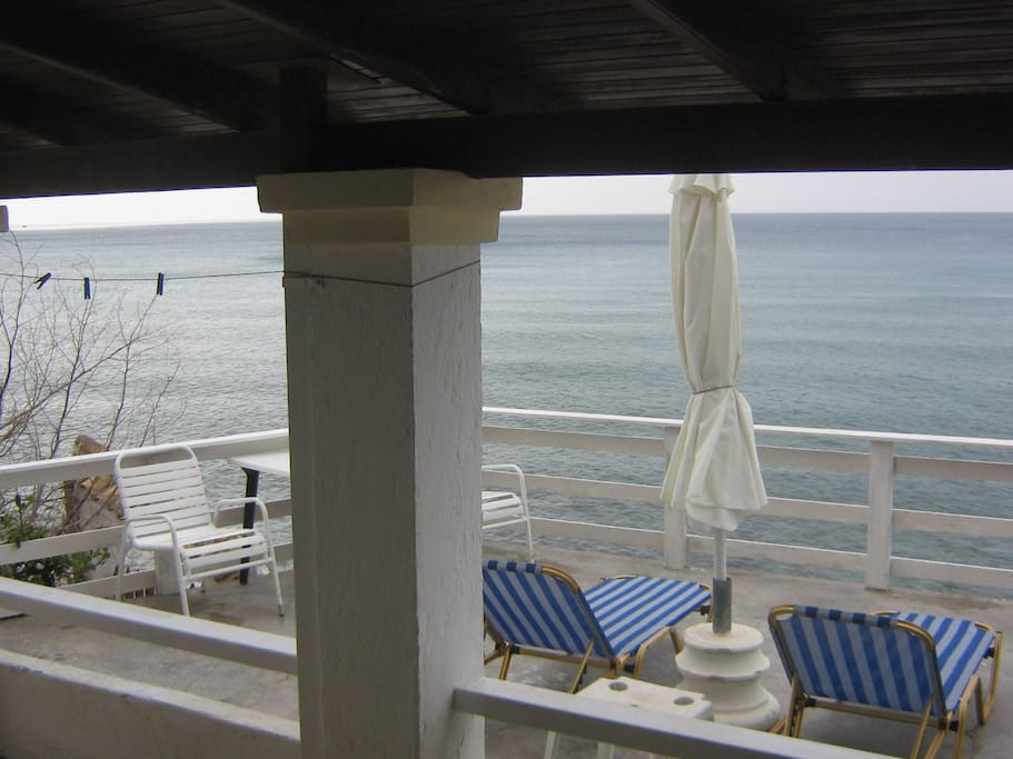 Sea front  large sun deck directly above the sea and beach