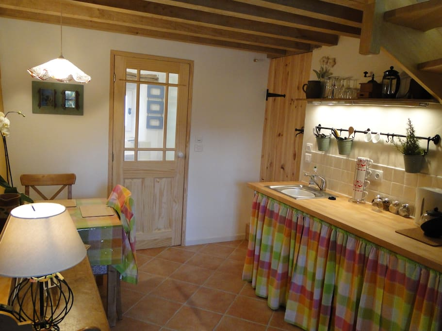 Interior of the Gite, Cooking facilities are hidden away but a hob and microwave are there for you