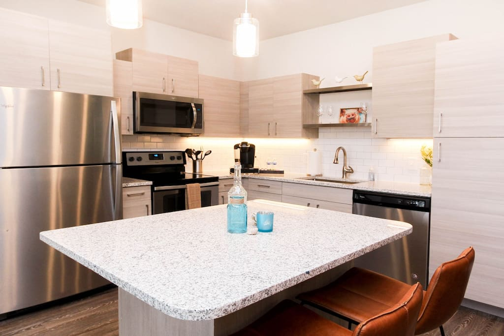 Entertaining kitchen featuring granite counter tops