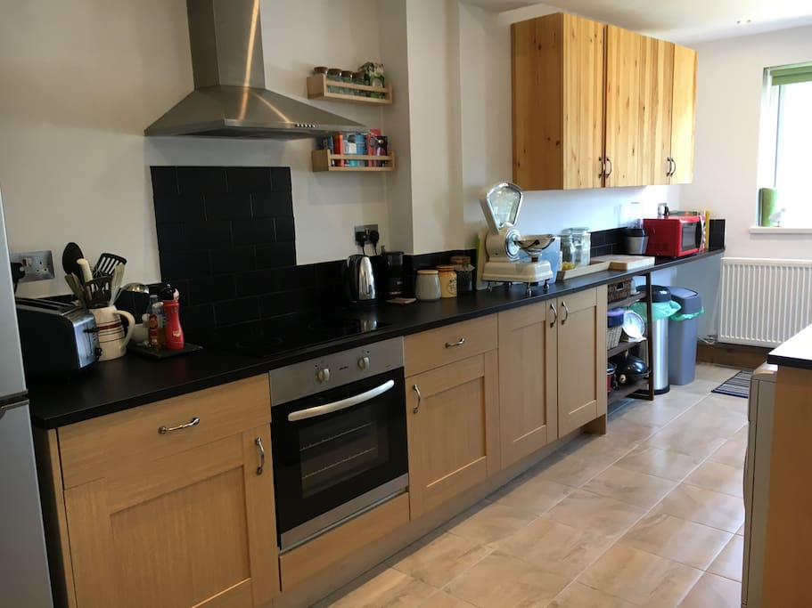 Kitchen - with large fridge/freezer, dishwasher, washing machine, microwave, coffee grinder