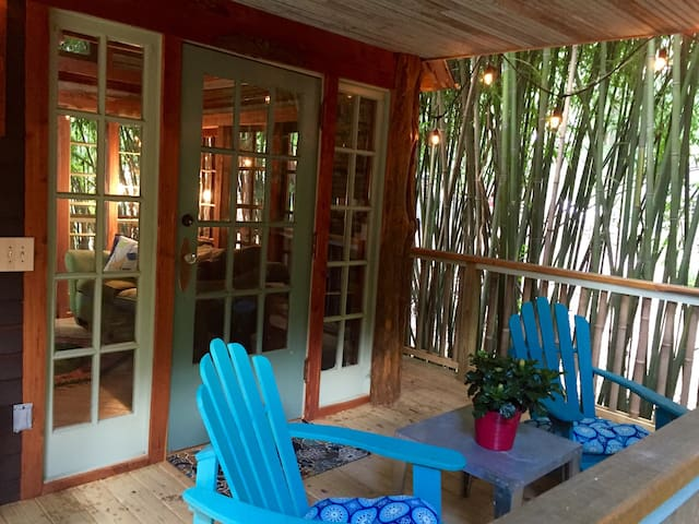 Serene and relaxing front porch with surrounding views of the bamboo forest.