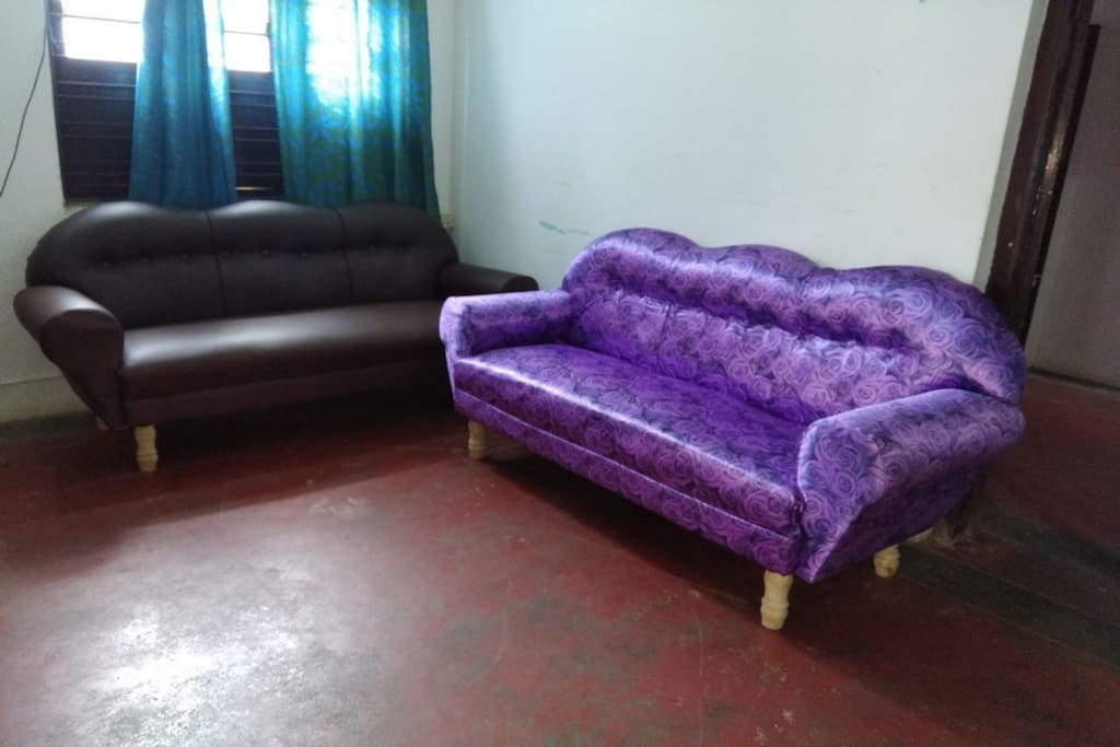 hall with tv and 2 number of sofa to sleep also