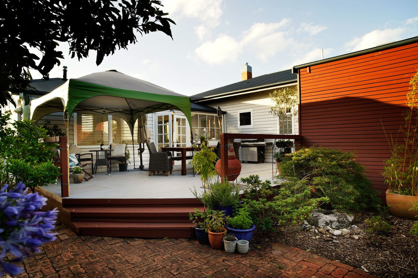 A large deck with a BBQ and outdoor heating. A large enclosed yard  will help keep your little people in or of if course your dog - Arghhh the serenity.