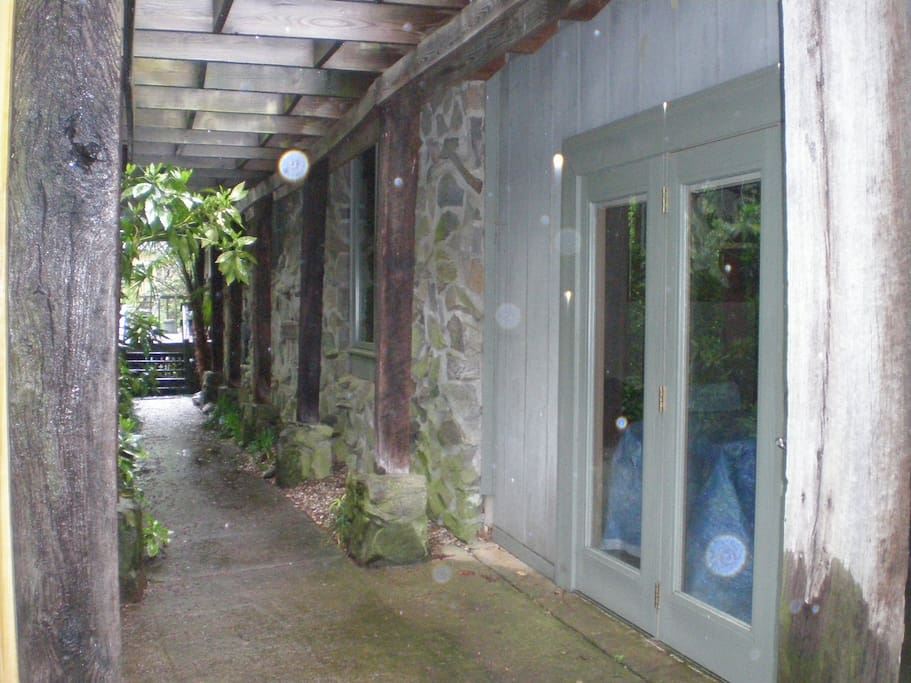 Main entrance to studio with greenery.