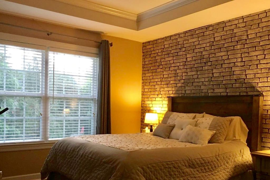 Wake up to the view of the tree-lined back yard and beautiful trey ceilings overhead