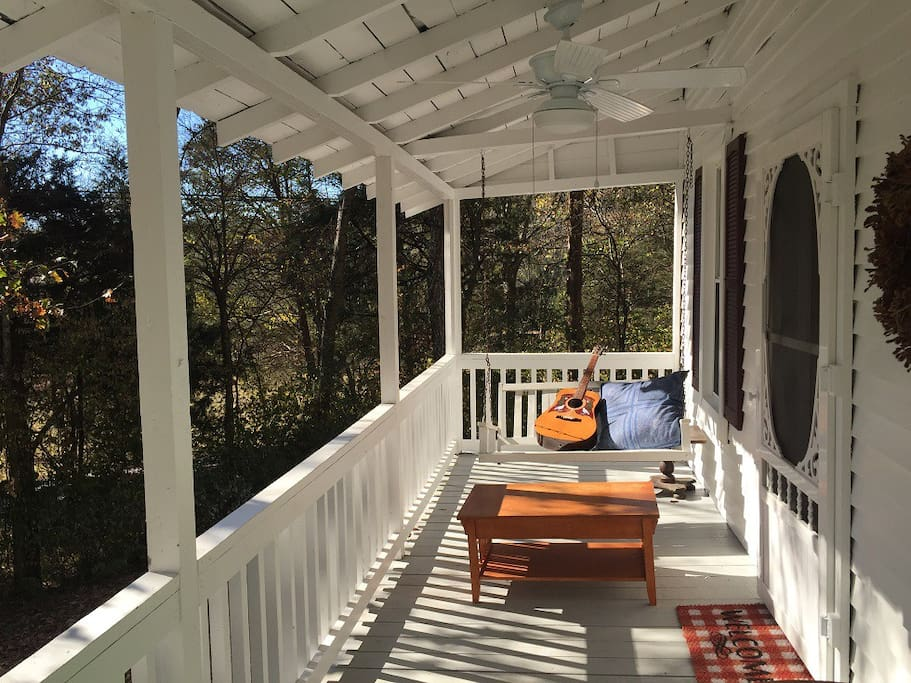 Relax and be creative on this big inviting front porch with porch swing and ceiling fans