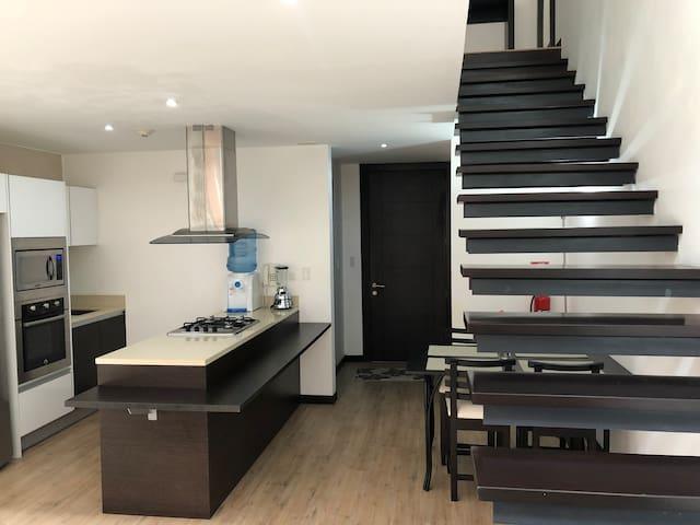 Kitchen and stairwell