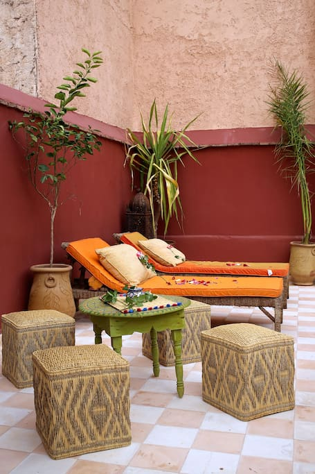 Large wrap-around sun terrace with loungers and seating