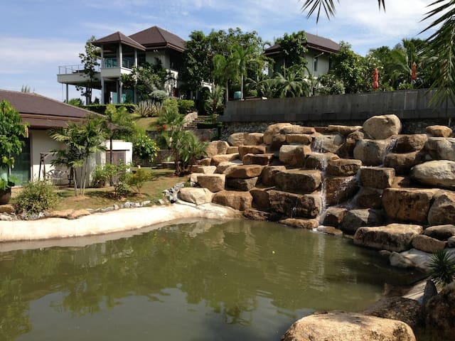 guest villa and waterfall with pond.