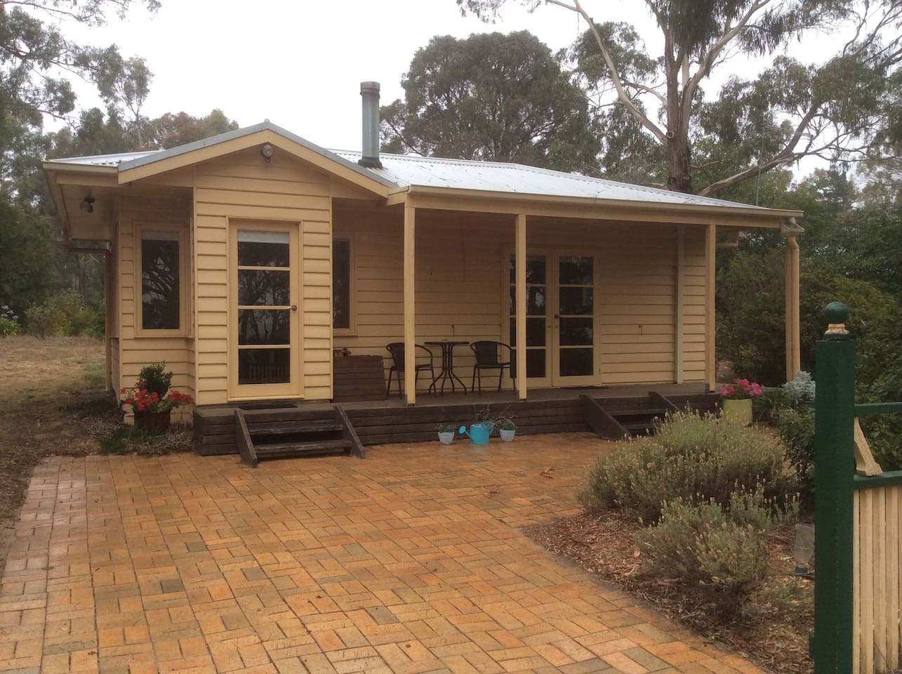 Front of cottage featuring parking and verandah