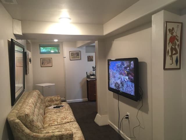 Sometimes referred to as the  Pilgrim's Couch, it is a great place to just lounge around. Notice the mini-refrigerator in the corner. it is always stocked with juices and milk. A new big screen TV with free Netflix now available to all guests.