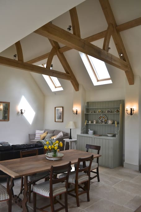 LIGHT & SPACIOUS LIVING/DINING AREA, OAK BEAMS & LIME STONE FLOOR.