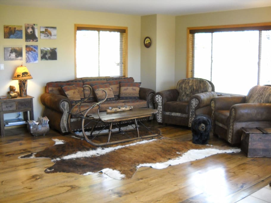 Living room- natural wood floors & animal skins- comfy and cozy