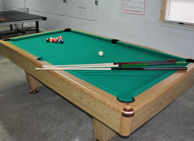Tournament size pool table in basement