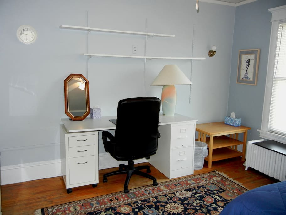 Blue Room has a Queen Bed, Desk, Sitting Chair, TV and DVD player.