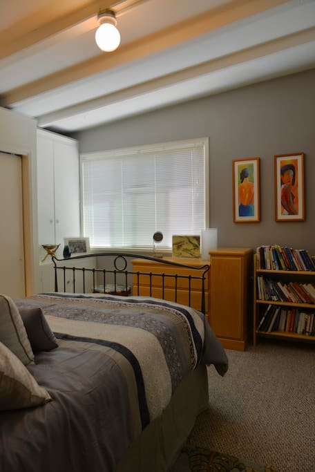 Nice bright lighting can be modified with mini-blind.  Inspirational books galore on the bookshelf! Vaulted ceiling adds nice touch to the feel of the room.  Window fan.