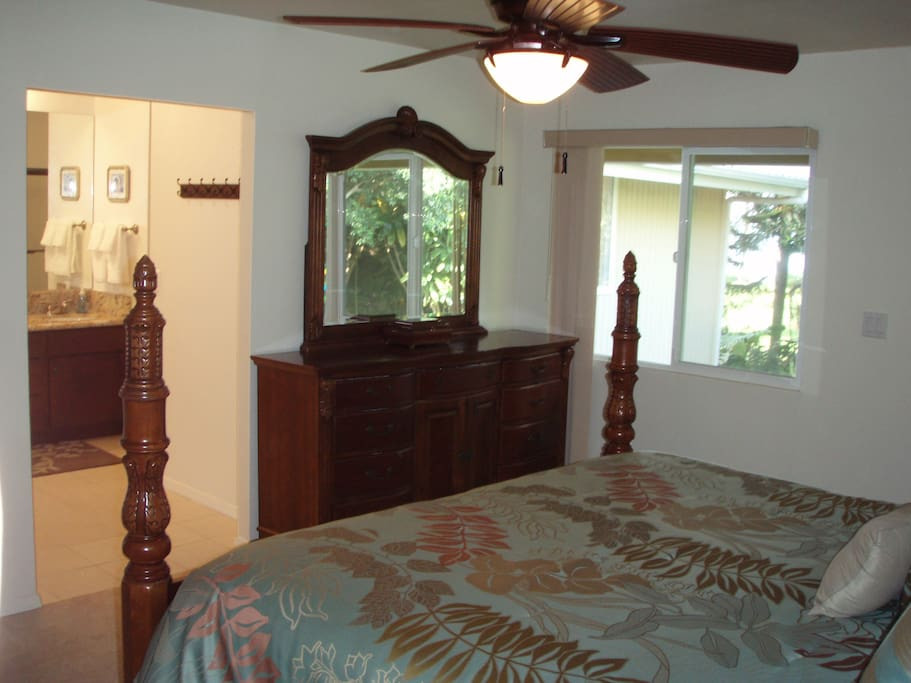 King bedroom with partial view of Hilo Bay and private bathroom