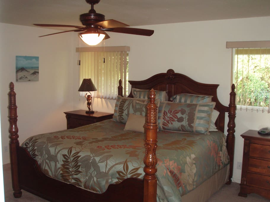 King bedroom with partial view of Hilo Bay