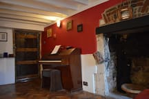 The other room.. feel free to have a go on the Piano!