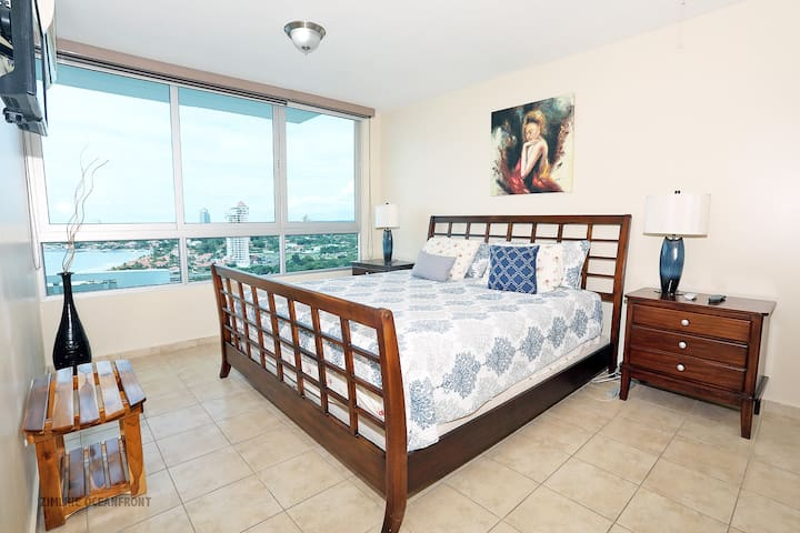 Master bedroom, king size bed and 18th floor ocean - mountain views from sliding glass windows