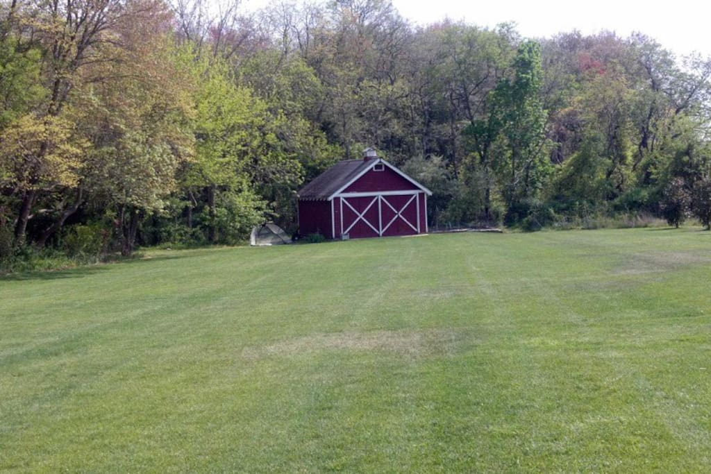 ~1.5 acres of grass and a classic barn
