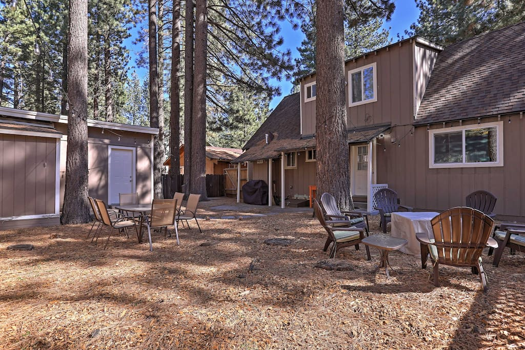 Become one with nature when you retreat to this forested location with a spacious backyard.