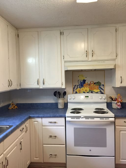 updated kitchen with tile mural