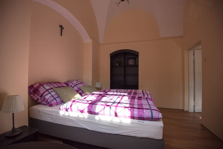 One bedroom with two beds. The picturesque arches create a unique atmosphere.