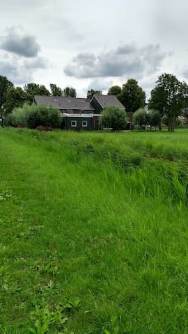 Behind the house are meadows