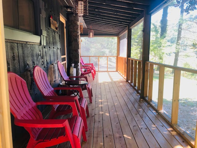 Relax and enjoy your morning coffee or a glass of wine on the screened in front porch looking out over the lake and marina.