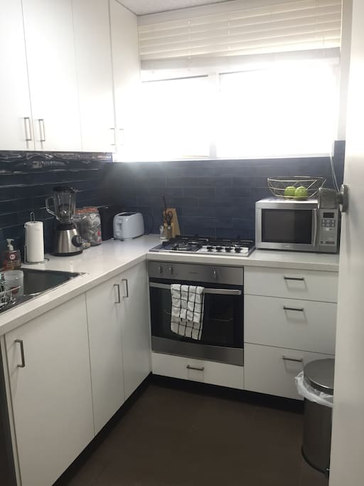 Brand new kitchen with fridge, microwave, toaster, oven, gas stove, espresso machine, espresso pods, black and green tea. Natural light and separate from sleeping and living area.