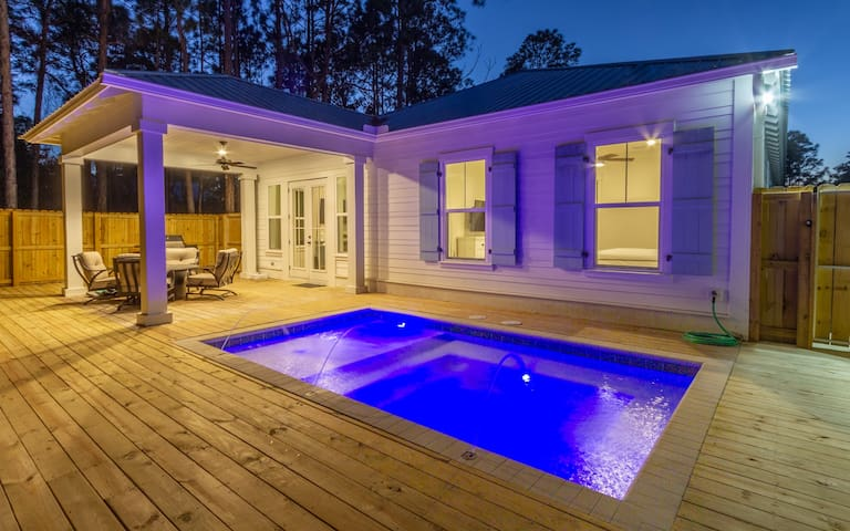Back deck features a dipping pool and fire pit