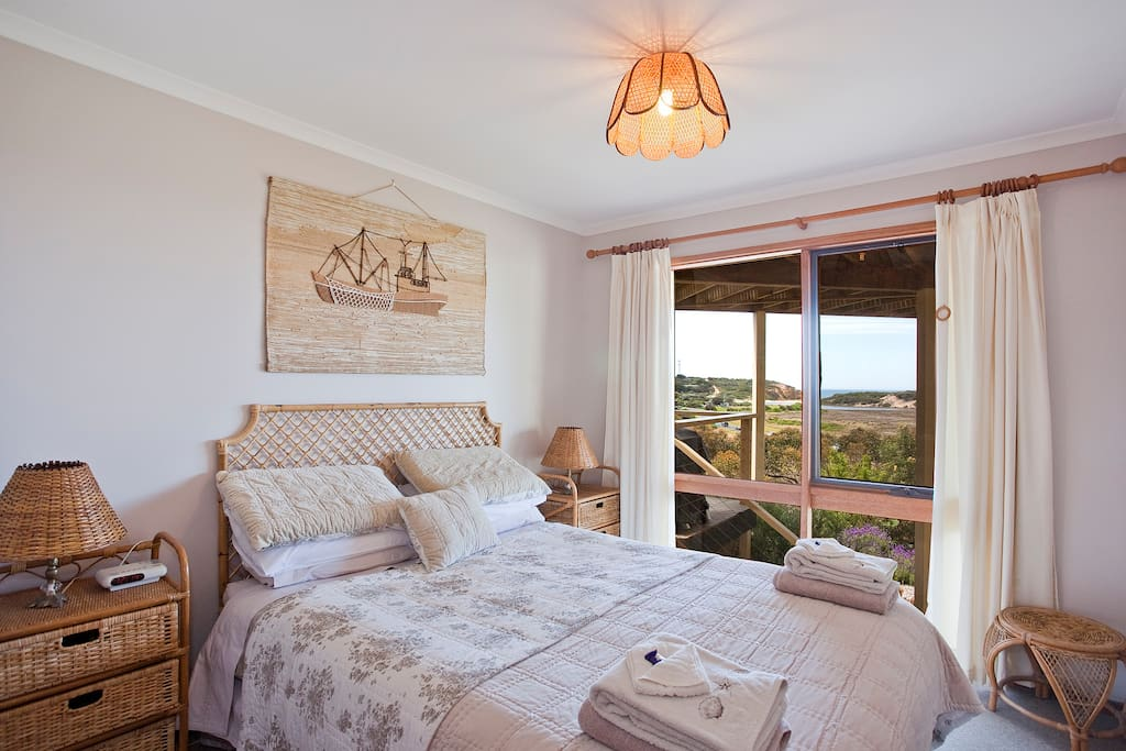 main bedroom with queenbed, silky sheets to slide into after a big day at the beach.