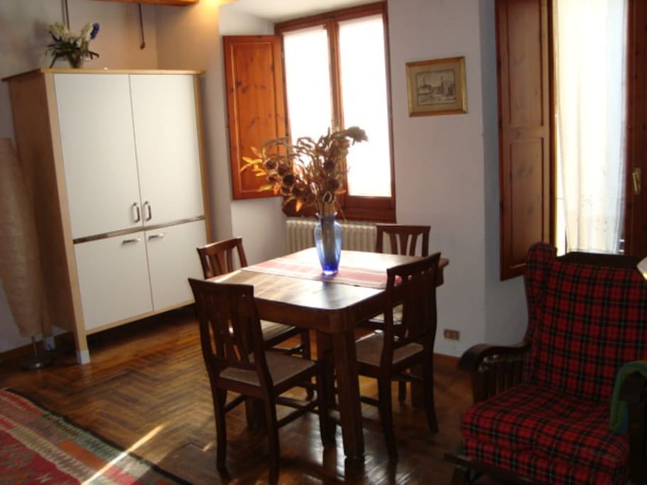 living room with kitchenette inside cupboard