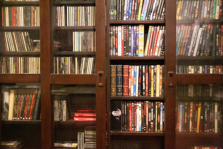 Hundreds of DVDs, CDs (can be played on DVD player) and some books.