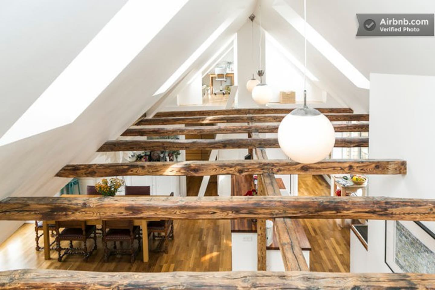 A view over the beams from one loft room to the other loft room.