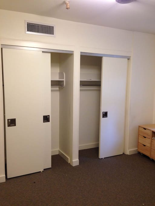The room has two closets, one for each bed