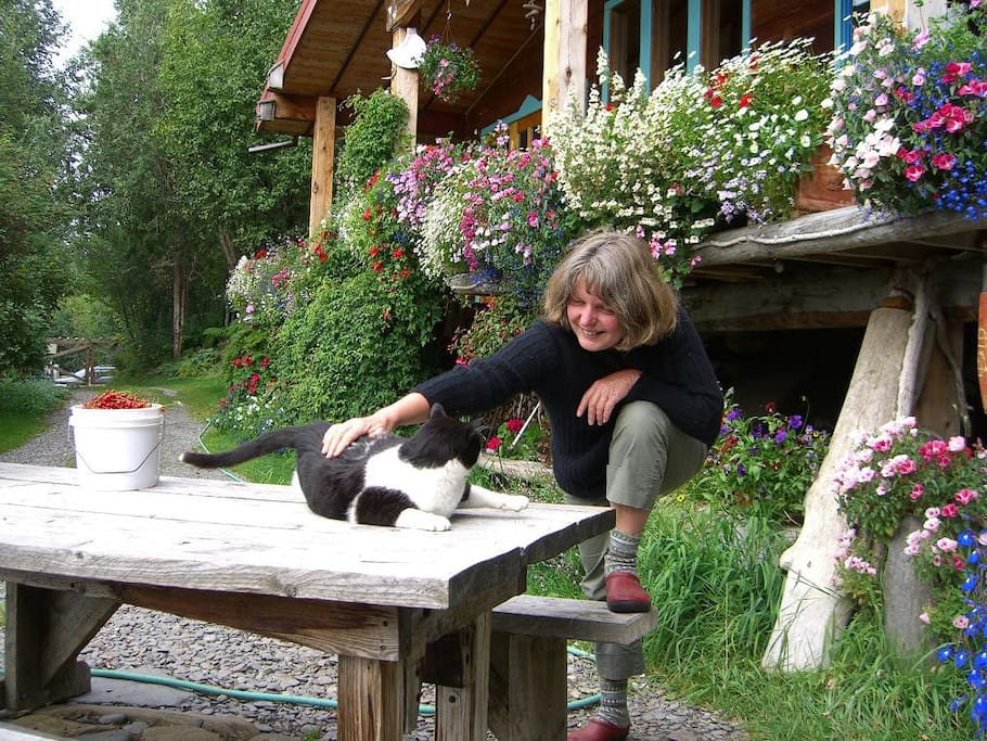 After picking berries, Brigitte has some time-out with Sigi, the out-door cat