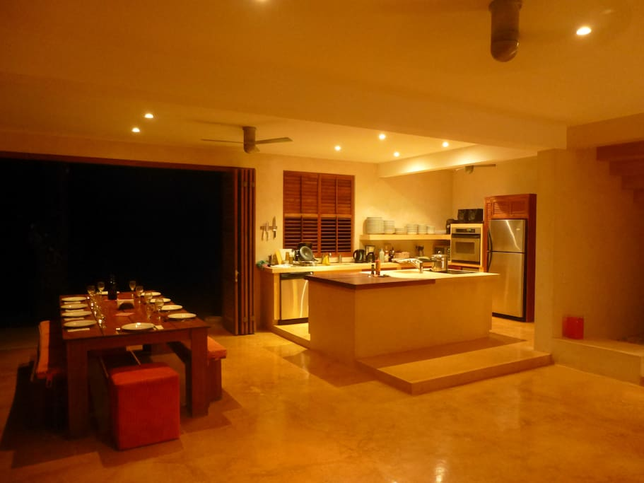 Open plan kitchen and dining area seating 12 persons