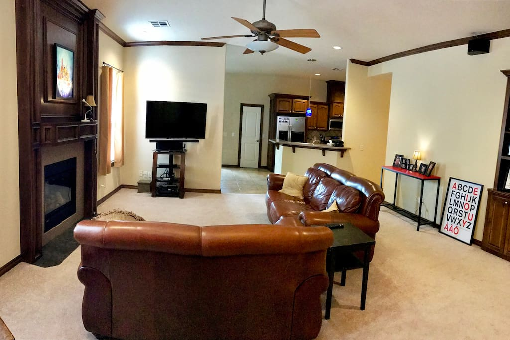 "Living room, couch and love seat and 55"" TV with Netflix and local channels. Fireplace is electric."