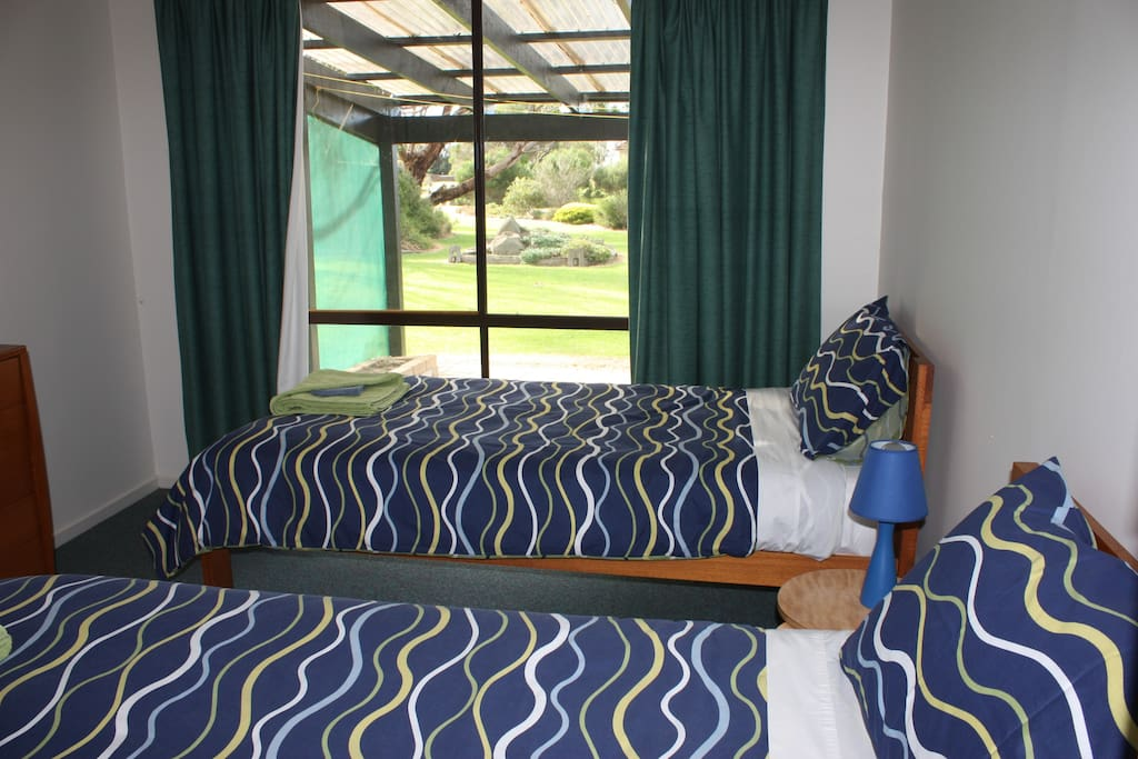 Bedroom 3 with two single beds and view of the garden