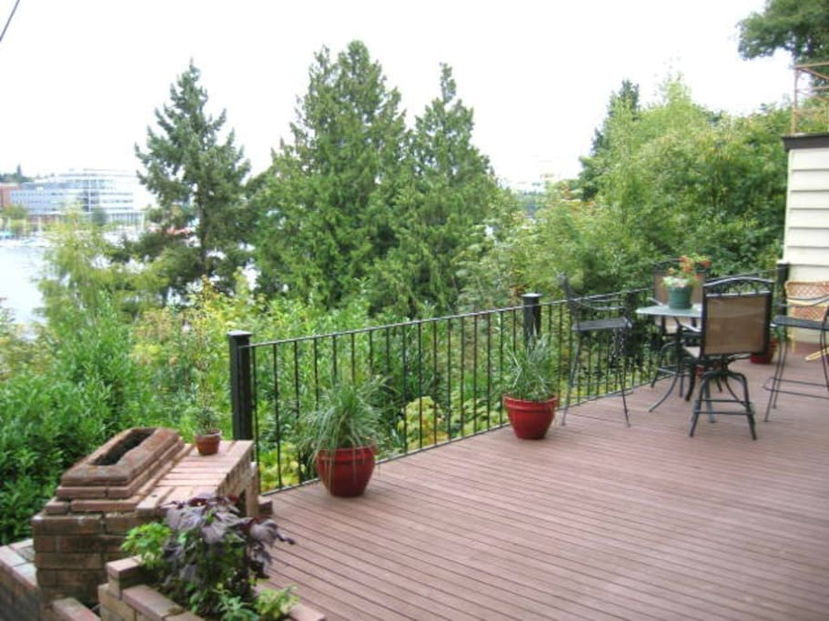 Enjoy dining al fresco on your huge patio overlooking the trees to the right and Portage Bay straight on and to the left
