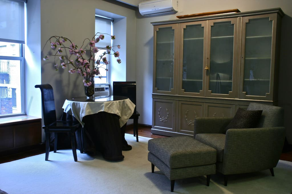 "View of the studio at dusk from the north-west corner showing custom armoire housing a 42"" TV (with cable)"