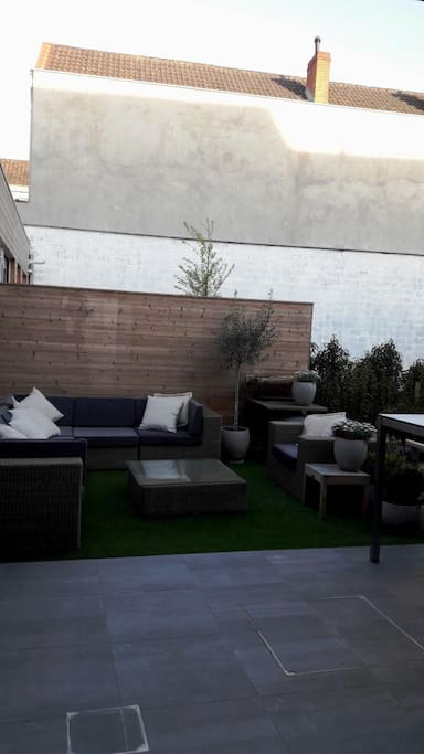 Cozy private garden with lounge corner