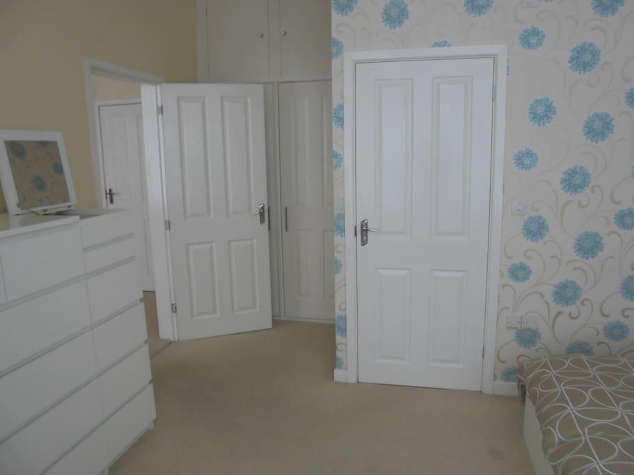 Bedroom doors leading to bathroom and living room