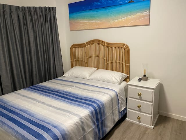 Front Bedroom with Queen size bed and single bunk bed
