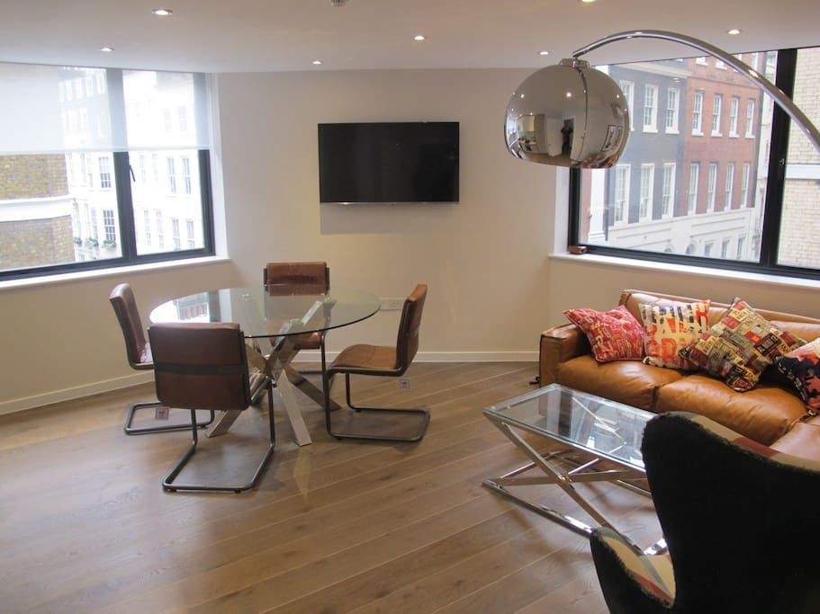 A spacious open plan living room and kitchen.