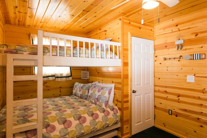 """""""Bunk beds perfect for the kids. The our family of four enjoyed our stay. The cabin has everything."""" - Kim"""